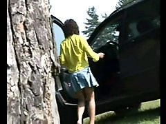 4 movies - Brunette gets out of the car to empty her bladder