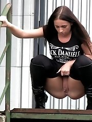 15 pictures - Stunning brunette is desperate to pee outside