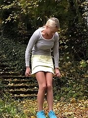 15 pictures - Hot blonde is desperate to piss while outside